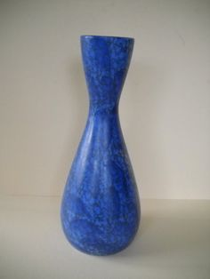 Excellent condition on this stunning blue vase. No chips or cracks. Marked on the bottom Madeline Originals California USA. Produced in the 1950s-1960s . Great design and matte glaze.  11 1/2 x 3 3/4 approx size