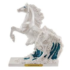 """SPRING 2012 PAINTED PONIES  A GIFT FROM THE SEA  Artist: Kim McElroy    According to legends, the Greek god Poseidon ruled the seas from a palace on the ocean floor, made of coral and gems. It is know that if you give a gift, the most beautiful thing on the face of the earth, that person will be yours.    Size: 8.5""""H x 4""""W x 7""""L  Stone Resin with Brass Title Plaque  $50."""