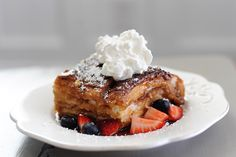 """Recipe for incredible Sugar Crusted Caramelized Over Night French Toast.  Serve warm with berries, whipped cream and a little powdered sugar and let your little munchkins who have been anxiously turning on the oven light every 30 seconds and asking you """"how much longer until it's ready??"""" dig in!"""