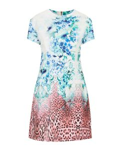 Vestido lady con mix de estampado de flores y leopardo. Es de Topshop, 88 €.
