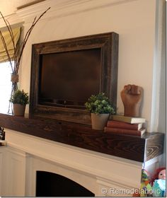 Here's the tutorial for making a frame to go around your flatscreen TV. I really like the look of this. | Remodelaholic