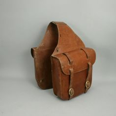 use saddle bags style as leather top to connect to overall pants. Attach by belt buckle or button buckle. can be detached and overalls worn as pants w/out leather top pc. Leather Saddle Bags, Leather Art, Custom Leather, Leather Tooling, Used Saddles, Biker Gear, Bike Bag, Vintage Bags, Leather Accessories