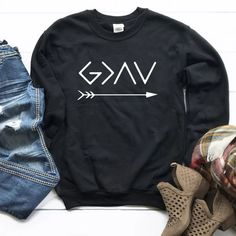 God Is Greater Than The High Low Arrow Sweatshirt Unisex Women Long Sleeve Religious Christian Graphic Jumper Hoodies Pullovers Christian Hoodies, Christian Clothing, Christian Apparel, Clothing Company, Black Sweaters, Kids Shirts, Shirt Designs, Cute Outfits, High Low