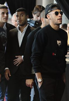 Neymar, Rafinha Alcantara and Jordi Masip pay tribute to late Dutch football star Johan Cruyff in a special condolence area set up at Camp Nou stadium on March 29, 2016 in Barcelona