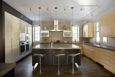 Niche Modern Pharos Modern Pendant Lights over a Kitchen Island