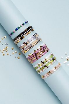 Create personal jewellery with pretty glass beads from Japanese label, Miyuki. With the Miyuki Tila bead series, you can create completely smooth bracelets to perfectly encircle your wrist. This is because Miyuki Tila beads are flat and have two parallel holes resulting in the smooth effect. Choose from an abundance of colours and give a bracelet or two as a gift. Voss Bottle, Water Bottle, Personalized Jewelry, Glass Beads, Jewellery Diy, Colours, Abundance, Bracelets, Label