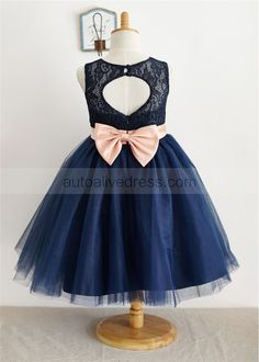 The dress is made of high quality lace,satin and tulle fabric.The listed color is navy blue with pink sash.It has a detachable bow at back waist,We cut keyhole back with 2 buttons to connect the top neckline.The tulle skirt is puffy and in knee length.Really suitable for wedding,holiday or party.For