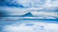 Heres incredible Mount Erebus on Antarctica as the volcano pokes its tip up through a cloud layer. #treyratcliff More on my blog at http://ift.tt/qCe472