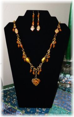 Necklace and earrings. Made from handmade lamp work beads, golden orange jade, tiny carnelian accent beads and gold plated chain and findings. Tiger heart focal is 1 in. Handmade Lamps, Handmade Jewelry, Jewelry Sets, Jewelry Making, Carnelian, Angel, Graphics, Jewels, Chain