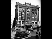 """Opened 1893, demolished 1978 -- Perhaps it's unfair to say that the Loew's Grand Theatre is """"gone"""" from the Atlanta landscape. True, the building itself no longer exists. But parts of it live on. Bricks from the old structure were used to build Houston's restaurant on Peachtree and a chandelier from the Grand now hangs in The Tabernacle for a new generation of concertgoers to appreciate. Fitting for a landmark that, during its lifespan, enjoyed an existence first as DeGive's Grand Opera ..."""