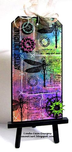 """I like to make what I call a """"simple tag""""....layers of colors, stamps, pen ink...and a couple of 3D pieces.  So I started with a new ..."""
