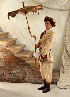 Venice Carnival 2013:Historical costumes:Scarlatti  Composed by: white and yellow silk compound fabric jacket and trousers with bordeaux long sash and roll hat with interlaced patterns, silk shirt with cuff lacing and lace jabot, tights, gloves.Sizes available L