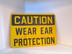 Vintage Industrial Sign Caution Wear Ear Protection. $35.00, via Etsy.