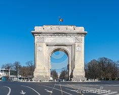 Arc de Triumph in Bucharest (Romania), a famous copy of the one in Paris, during a sunny autumn day.