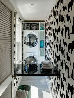 """Wall-to-Wall Dogs - To create the illusion of a bigger, wider space in this long, narrow laundry room, designer Jenna Wedemeyer selected a graphic black-and-white flocked pup-print wallpaper called """"Best in Show"""" from Osborne & Little."""