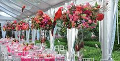 centerpiece entertaining non-profit gala reception roses round tables table setting tall centerpiece tent vase color|coral color|green color|lilac color|pink color|purple color|red color|white