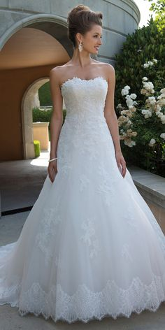 Pretty Tulle Strapless Neckline A-line Wedding Dress With Lace Appliques & Beadings