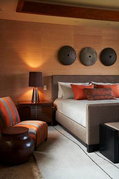 "Designed by Willman Interiors, Kamuela, HI. Love the subtle orange details that lend softness to the lighting. Nothing I love more than ""grasscloth"" wallpaper - so warm and inviting!!"