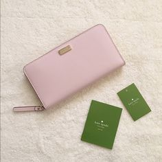Kate SpadeWallet ⚜Kate Spade⚜Newbury Lane Neda Saffiano Leather Zip around wallet• ✨Brand new with tag and care card•✨ Guarantee authentic ONLY $110 on Viinted or Mercarii!!  Details:  Color: posypink  Saffiano leather Zip-around closure Brand logo gold hardware Features a center zip pocket 12 card slots and 2 bill compartments Lined interior  7.5 x 4 kate spade Bags Wallets