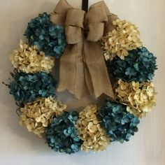 This beautiful wreath is made on a grapevine wreath frame. Its also made with cream and turquoise hydrangeas and a burlap bow. The wreath is approximately 20 in diameter.  Wreath can also be made with cream mixed with different color hydrangeas. Select color at checkout.  This product can only be shipped within the 48 contiguous states. Thank you for visiting my shop.