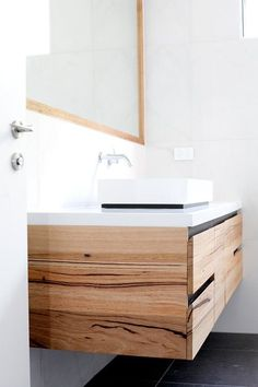 floating timber vanity with black accents