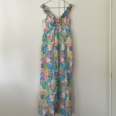 Like new Lily Pulitzer maxi dress! Long maxi dress designed by Lily Pulitzer, size 4. It is a light cotton material perfect for the spring and summer months. It has a feminine ruffle around the neckline that is very flattering. It has barely been worn. Lily Pulitzer Dresses Maxi