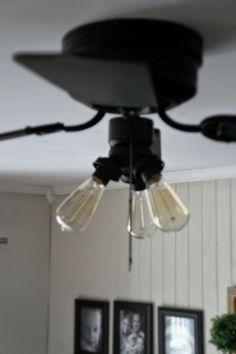 Super Easy Industrial Style Fan Makeover - Seeking Lavendar Lane Updating a Ceiling Fan spray them white/black with edison light bulbs. Ceiling Fan Makeover, Industrial Style, Diy Ceiling, Ceiling Fan With Light, Light, Ceiling, Bulb, Lights, Diy Fan