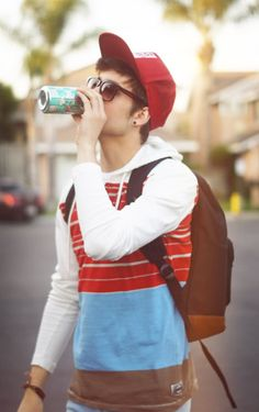 young men's street fashion style trends with a hoodie and backpack