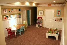 Fun Ideas for Kids Basement Playroom :: I love the simplicity of this room. Especially having a table set aside for art projects...but not with carpet under the table...