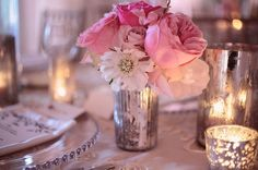 Mercury candle votives and vase with delicate pink flowers. So romantic and beautiful for a feminine tablescape.