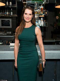 Classic beauty: Brooke Shields, 51, looked lovely in a sleeveless dark green dress at a book launch in NYC Wednesday night
