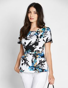 The Peplum Top in Garden Party is a contemporary addition to women's medical scrub outfits. Shop Jaanuu for scrubs, lab coats and other medical apparel.