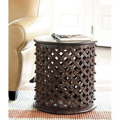 Ballard Designs Bornova side tables at $219.00 are a bargain   http://www.ballarddesigns.com/bornova-side-table/tables/accent-tables/15106?listIndex=4  They are produced by others at much higher prices while you get much more bang for your buck here.  I would give them a coat of tinted briwax to tone them down if they were mine.