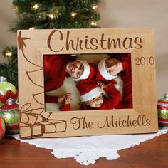 """#Christmas Tree Personalized Wood Picture Frames. Personalized Christmas Tree Picture Frame - Engraved Christmas Picture Frame. Christmas is a wonderful time of the year to share a warm, family portrait or fun photo of the kids with the Grandparents, Aunt, Uncle or distant relatives. Our Christmas Tree Personalized Wood Picture Frames measures 8¾"""" x 6¾"""" and holds a 3½"""" x 5"""" or 4"""" x 6"""" photo. Easel back allows for desk"""