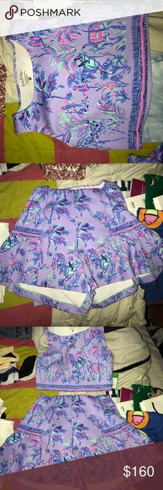 Lilly Pulitzer Two Piece Set adorable fit, never worn, love the color of this set so different from other lilly! isnt sold anymore so this is a rare find! shorts flare to look like a skirt fit Lilly Pulitzer Dresses