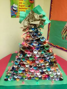 Christmas Tree from recycled materials: toliet paper rolls wrapped with magazine pages and a colored paper topper. Mayaguez, Puerto Rico