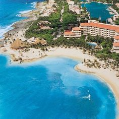 Dreams Puerto Aventuras Resort & Spa, Playa Del Carmen looks out on a yacht-filled marina and the Caribbean Sea.