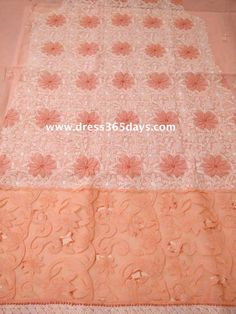 peach embroidered fabric