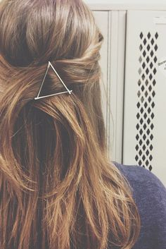 A pretty way to use bobby pins. Make patterns and shapes to spruce up a hairstyle.