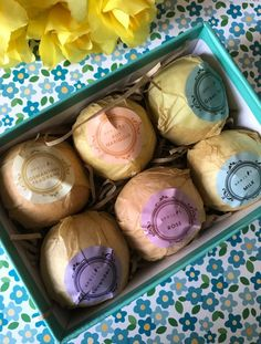 Aprilis Bath Bombs box open to show 6 wrapped bath bombs in different scents, neversaydiebeauty.com