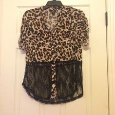 Leopard Print with Lace Top This gorgeous leopard print with lace top is a perfect evening or day wear! It is a button down blouse with leopard print for the top half and lace for the bottom half. The leopard print half is 100% polyester and the lace is 100% nylon. Let me know if you're interested! Rue 21 Tops Button Down Shirts