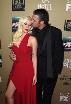 Lady Gaga and her handsome fiancé, Taylor Kinney, aren't afraid of a little red carpet PDA