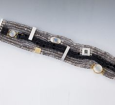 Sterling silver, 18KT yellow gold, white and grey Moonstone, and Onyx Bracelets | Janis Kerman Design