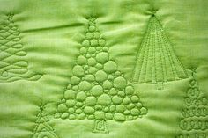 Great idea for free motion quilting Christmas trees.