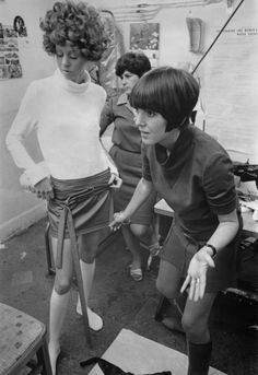 Mary Quant adjusting a miniskirt on a model, 1967