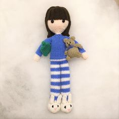 Free knitting pattern for doll with her teddy bear, bunny slippers and hot water bottle.
