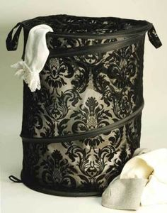 """Brocade Pop-Up Hamper      This clever little laundry bin collapses to the size of a  thin platter and expands to hold a full load! Wired spiral spring.  Ziptop with buttontabs. Flocked polyester. 15x24"""".        VTC Exclusive!"""