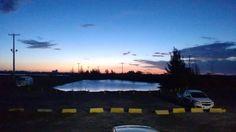 Universidade Veiga de Almeida campus Cabo Frio | Cabo Frio, RJ / BRASIL | photo by Rachel Monteiro (@/qchelq on Instagram).  #uni #university #uva #sky #sunset #amazingsunset #lake #paradise #ovni #ufu #mistic #water #tree #trees #parking #horizon #cabofrio #rj #rio #riodejaneiro #brasil #brazil #paradise #blue #cloud #clouds #cloudly #sky