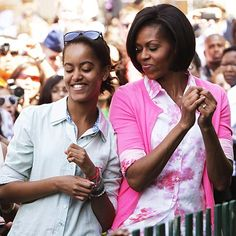 Michelle Obama : love the floral top and pink sweater combo