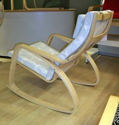 """Ikea Poang Rocking Chair  Reviews say it is very deep, and very reclined.  Not good for short people.  Can't reach floor.  Width: 26 3/4 """" Depth: 37 """" Height: 37 3/8 """" Seat width: 22 """" Seat depth: 19 5/8 """" Seat height: 17 3/4 """""""